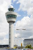 Schiphol Airport Command Tower Against Cloudy Sky