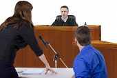 stock photo of innocence  - defendant with lawyer speaking to a judge in the courtroom - JPG