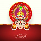 Beautiful illustration of Goddess Duraga face wearing a nice crown in red decorated with pearls and beads on red and white background.