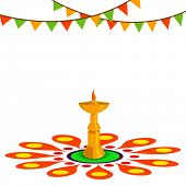 Golden oil lamp on beautiful rangoli decorated background for South Indian festival Happy Onam celebrations.