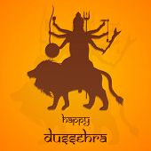 Beautiful illustration of Goddess Durga with six weapon holding hands sitting on her lion with image shadow on bright orange background.
