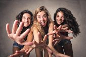 three young women that are having fun together