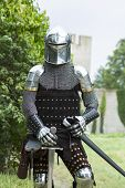A man in armour outside