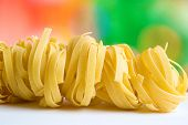 Row Dry Nest Pasta On Colored Background