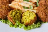 Falafel With French Fries, Lettuce On A White Plate Macro