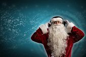 Santa Claus is listening to music