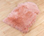 decorative fur carpet on wooden floor