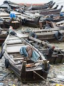 Boats Along A Polluted Seaside In Myanmar