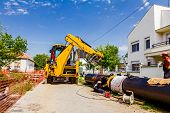 image of heavy equipment operator  - Work is in progress welding pipeline in urban area - JPG