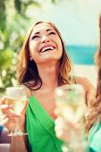 summer holidays, vacation and celebration - girl with champagne glass