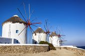 Traditional whitewashed windmills on island of Mykonos, Greece.