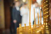 stock photo of church interior  - Burning candles in a Russian ortodox church - JPG