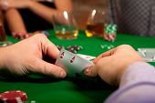 foto of poker hand  - Pair of aces in his hand poker player - JPG