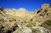 foto of ravines  - Ravine and mountain in Negev desert - JPG