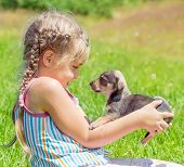 A child with a puppy