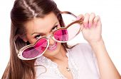 Young brunette with big heart-shaped sunglasses