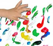 stock photo of finger-painting  - Kid paints with her fingers with different color paint - JPG