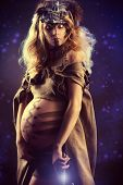 Beautiful pregnant woman warrior. Ancient times. Fantasy.