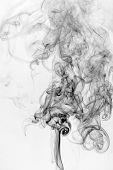 smoke background and texture with puffs and swirls from burning incense sticks