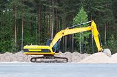 foto of boom-truck  - Photo of hydraulic crawler excavator on the construction site - JPG