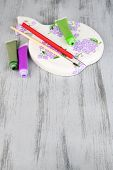 Beautiful hand made cutting board and art materials on wooden table