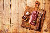 picture of machete  - Raw fresh meat Steak Machete with salt and pepper on wooden background - JPG