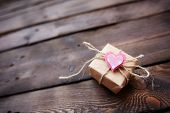 Giftbox with small pink heart on its top