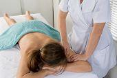A Nice Woman Back Massage  On  Massage Table