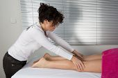 At A Spa Center A Woman Receiving A Massage On Her Legs