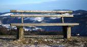 Wooden Bench Isolated In The High Mountain Landscape