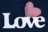 Wood Love text with red heart on blue denim fabric background