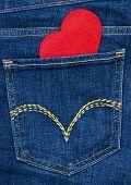 Red heart in blue denim jeans