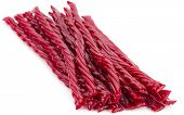 stock photo of licorice  - Red licorice candy shaped like a twisted rope isolated on white background - JPG