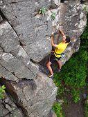 Young man climbing.
