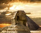 pic of pyramid shape  - The Sphinx and the pyramid of Cheops in Giza in the background of a sky Cairo Giza - JPG