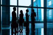 stock photo of city hall  - Group of business people standing in lobby or hall - JPG