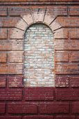 element of architecture. arch on brick wall. empty window.