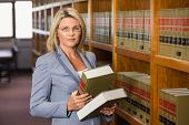 stock photo of lawyer  - Lawyer reading book in the law library at the university - JPG