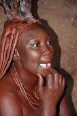 Woman from Himba tribe showing her 4 missing front teeth