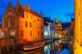 Cityscape with the picturesque night canal Dijver in Bruges