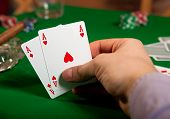 image of poker hand  - Pair of aces in his hand poker player - JPG