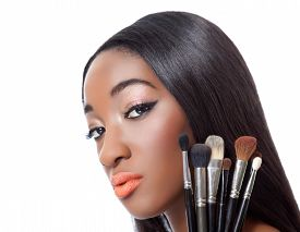 stock photo of afro hair  - Black woman with straight hair holding makeup brushes isolated on white - JPG
