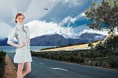 picture of air hostess  - Pretty air hostess with hand on hip against scenic backdrop - JPG