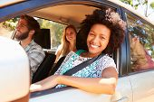 picture of road trip  - Group Of Friends In Car On Road Trip Together - JPG