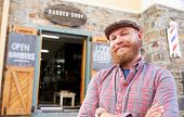 picture of facial piercings  - Portrait Of Hipster Barber Standing Outside Shop - JPG