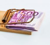 foto of debt free  - many euro banknotes in a mousetrap - JPG