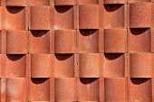 picture of cylinder  - A beautiful brick color in a cement wall - JPG