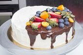 picture of kumquat  - Cake with strawberries, blueberries, kumquat drizzled with chocolate ** Note: Visible grain at 100%, best at smaller sizes - JPG