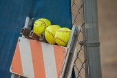 stock photo of softball  - Softball field accessories and a few extra balls - JPG