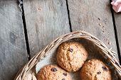stock photo of baked raisin cookies  - Cookies in a basket - JPG
